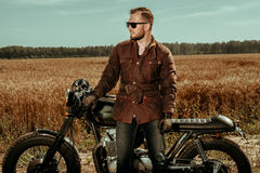 Rider with his vintage custom made cafe racer Stock Photo