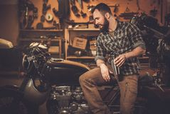 Rider and his vintage style cafe-racer motorcycle Royalty Free Stock Photo