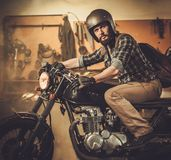 Rider and his vintage style cafe-racer motorcycle Stock Photo