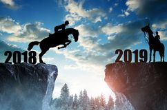 The rider on the horse jumping into the New Year 2019. Stock Image