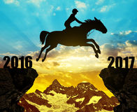 The rider on the horse jumping into the New Year 2017. At sunset Stock Images