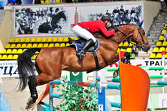 Rider with horse jumps over a hurdle Royalty Free Stock Photo
