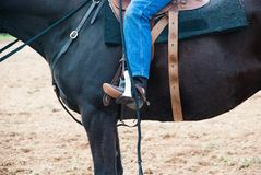 A cowboy - rider on on the horse. Victoria, Australia. A rider on the horse. Horse saddled, bridal on. Horse Jeans and cowboy boots and spurs stock photography