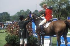 Rider on horseback being led Stock Photo