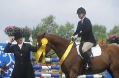 Rider on horseback with ribbon Stock Photos