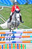 Rider on jump horse Stock Photo