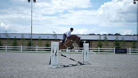 Rider jump over the barrier on the horseback stock footage