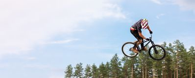 Rider is jumping high on a bicycle. Copy space stock photography