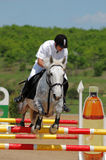 Rider in jumping show Stock Photo