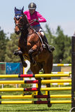 Rider Jumps Horse At Horse show Royaltyfria Foton