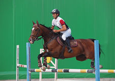 A rider jumps over the hurdle Royalty Free Stock Photos