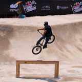Rider Jumps Over Wooden Bar. Fotografie Stock