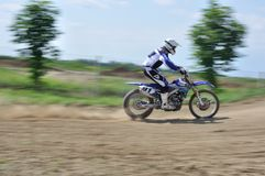 Rider. Motocross challenge in dirty ground Royalty Free Stock Photos