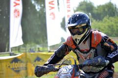 Rider. Motocross challenge in dirty ground Royalty Free Stock Image