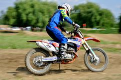 Rider. Motocross challenge in dirty ground Stock Photography