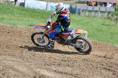 Rider. Motocross challenge in dirty ground Royalty Free Stock Photography