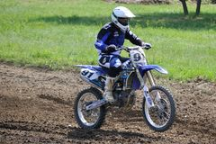 Rider. Motocross challenge in dirty ground Stock Images