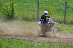 Rider. Motocross challenge in dirty ground Stock Image
