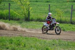Rider. Motocross challenge in dirty ground Stock Photos