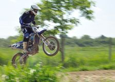 Rider. Motocross challenge in dirty ground Royalty Free Stock Photo