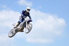 Motocross jump Rider. Motocross challenge in dirty ground Royalty Free Stock Photography