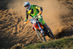 Rider during motocross race. A motocross rider raises a cloud of dust during a race stock photo