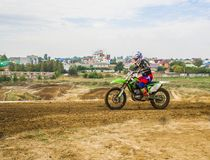 A rider on a motorcycle participates in a motocross race, rides. The sand. Close-up. Extreme sports Royalty Free Stock Photo