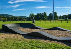 A Rider on a Onewheel Motorized Skateboard. Roanoke, VA – OCT 19th: A rider on a onewheel motorized skateboard on a BMX track located in Wasena stock photo