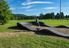 A Rider on a Onewheel Motorized Skateboard - 3. Roanoke, VA – OCT 19th: A rider on a onewheel motorized skateboard on a BMX track located in stock image