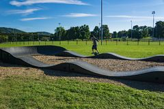A Rider on a Onewheel Motorized Skateboard - 4. Roanoke, VA – OCT 19th: A rider on a onewheel motorized skateboard on a BMX track located in stock photo