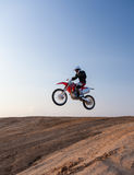 Rider performs stunts in desert Royalty Free Stock Photo