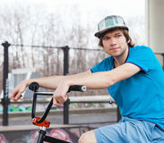 Rider posing with bicycle Stock Photography