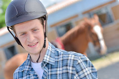Rider posing with horse Royalty Free Stock Image