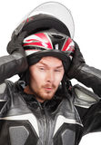 Rider pulling helmet out Royalty Free Stock Photos