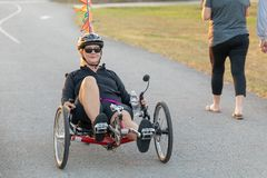 Rider on a recumbent bike. stock photo