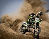 Rider Riding Green Motocross Dirt Bike Stock Photography