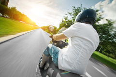 Rider on scooter motorcycle in parkway Royalty Free Stock Image