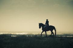 A Rider Silhouette on Horseback / retro style Stock Photos