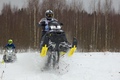 Rider on a snowmobile Royalty Free Stock Images