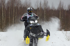 Rider on a snowmobile Stock Photos