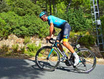 Leon Sanchez, Astana Pro Team. The rider stands as he climbs a mountain on stage eight Xorret De Cati in the 2017 La Vuelta España bike tour Stock Photography
