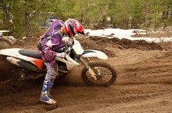 Rider stuck in deep ruts turning the sandy MX track Stock Photo