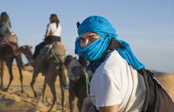 Rider tourist on camels caravan, Morocco Royalty Free Stock Photo