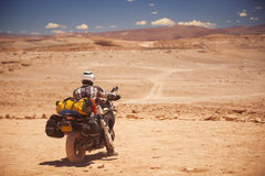 Rider travels. The Atacama Desert on a motorcycle. America Royalty Free Stock Photography