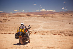 Rider travels. The Atacama Desert on a motorcycle. America Royalty Free Stock Photo