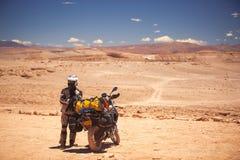 Rider travels. The Atacama Desert on a motorcycle. America Stock Photography