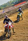 Rider at turning point. Two motocross riders duelling at turning point Royalty Free Stock Images