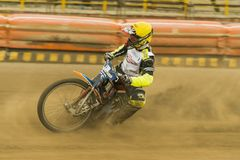Rider  Vladimir Trofimov overcomes the track. Rivne, Ukraine - 11 October 2015:  Rider  Vladimir Trofimov overcomes the track at the Open Cup Speedway to the day Royalty Free Stock Photography