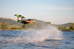 Rider wakeboarding in the cable wake park Merkur. PASOHLAVKY, CZECH REPUBLIC - JUNE 24, 2017: Rider wakeboarding in the cable wake park Wake Merkur in South Royalty Free Stock Photography
