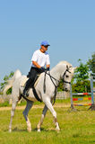 Rider on white arabian horse Royalty Free Stock Images